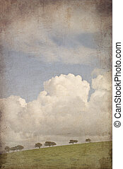 Retro grunge effect photo of countryside landscape with blue sum
