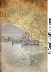 Retro grunge photo of View from a gondola under Rialto Bridge along Grand Canal in Venice Italy