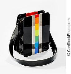 stylish old vintage handbag black patent leather colored plastic rainbow effect isolated on white