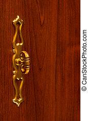 Retro handle on wooden door