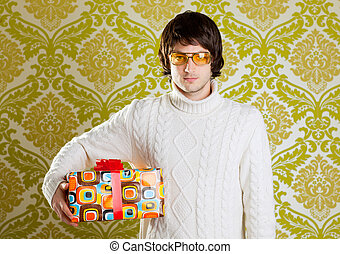 retro hip young man glasses holding  gift box