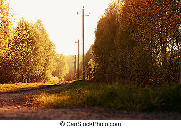 Retro image of road at sunset.