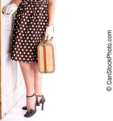 Retro image of woman holding luggage