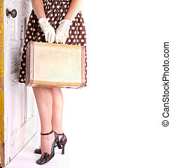 Retro image of woman holding luggage