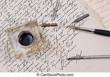 retro ink pen on old aged paper isolated on white