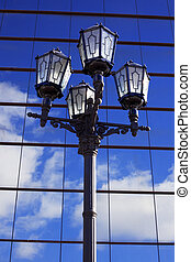 retro lantern against modern building