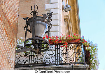 Retro lantern on the wall of ancient building on Cavour square in Rimini, Italy