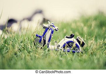 retro look, blue wired scooter. green grass and bokeh