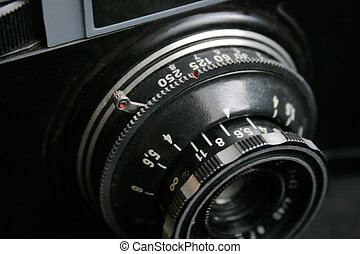 Close up of an outdated amateur camera objective. There are lot of numerals on it.