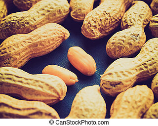 Vintage retro looking Peanut dry fruit or groundnut (Arachis hypogaea) beans - useful as a background