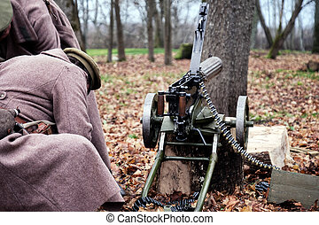 retro machine gun and soldiers in the forest