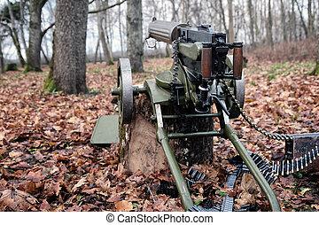 retro machine gun in the forest