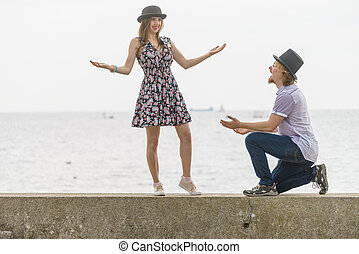 Retro man and woman having date outside