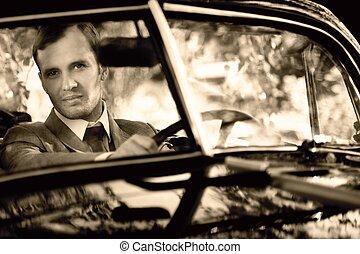 Retro man behind steering wheel