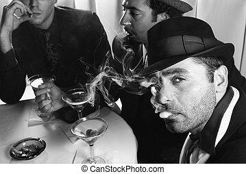 Retro men drinking martinis. - Three Caucasian prime adult...