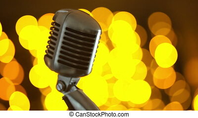 Retro microphone against colourful background.