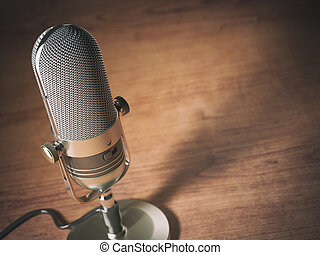 Retro microphone on the table with space for text. Vintage style background.