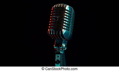 Retro microphone rotating on black background - Closeup of ...