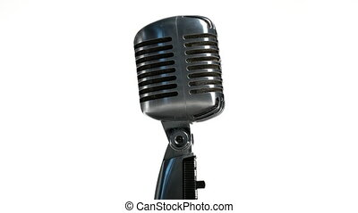Retro microphone rotating on white background - Closeup of ...