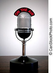Retro microphone with an \'On the Air\' illuminated sign on...