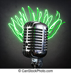 Retro microphone with green laser rays.