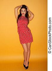 Retro model in a polka dot dress