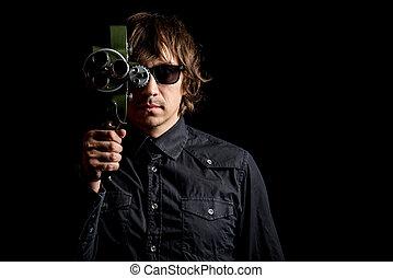 Retro movie camera. Guy takes on a retro movie camera.