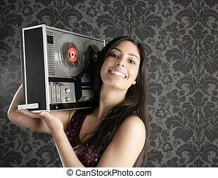 Retro open reel tape recorder beautiful brunette Dj hearing ...