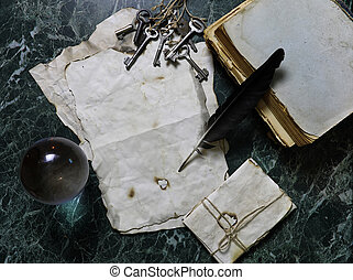 retro papers and book on table with detective tools background