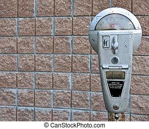 retro parking meter - old-fashioned parking meter on brick...