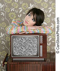 retro pensive woman on vintage wooden tv 60s wallpaper