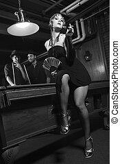 Retro people in pool hall. - Caucasian prime adult female...