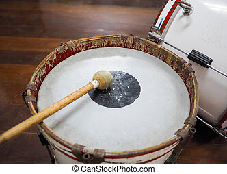 Military drum (Bass drum) with drum sticks.