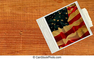 retro Photo Frame with USA flag against old wood