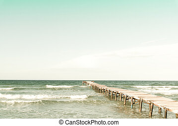 Retro photo of a pier in wood from the beach