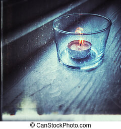 Retro photo of candle in glass