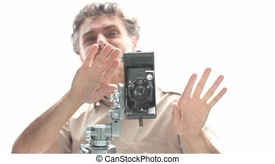 happy photographer with old retro camera