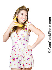 Retro pin up girl chatting on banana telephone