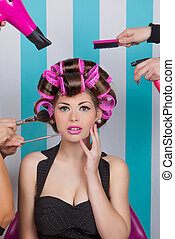 retro pin up woman getting pampered in beauty salon