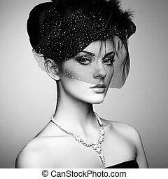 Retro portrait of a beautiful woman. Vintage style