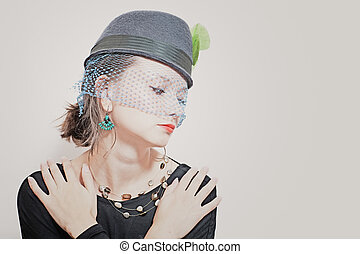 beautiful young girl wearing a hat with a veil