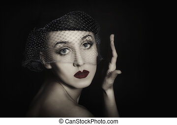 portrait of beautiful young woman in veil
