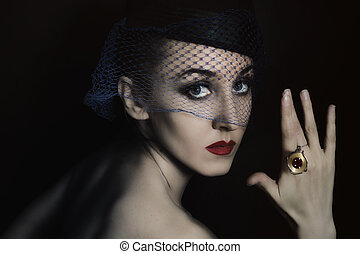 beautiful young woman in veil with ring