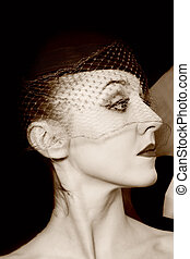 Retro Portrait of beautiful young women in veils closeup. Vintage style
