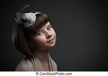 Retro portrait of elegant little girl on dark background