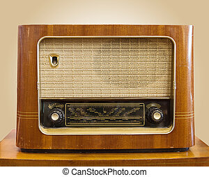 Retro Radio - Vintage fashioned radio on tan background