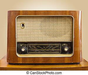 Retro Radio - Vintage fashioned radio on tan background