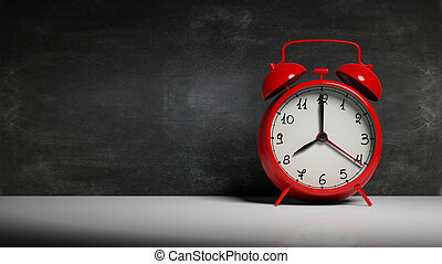 Retro red alarm clock with blackboard and copy-space