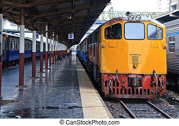 Retro Red orange train, Diesel locomotive, on Bangkok railway station platform Thailand