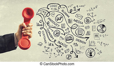 Retro red phone receiver - Close of woman holdingn in hand...